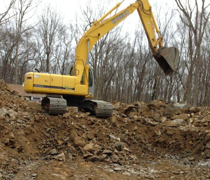 pond construction in Danbury CT - excavator digging